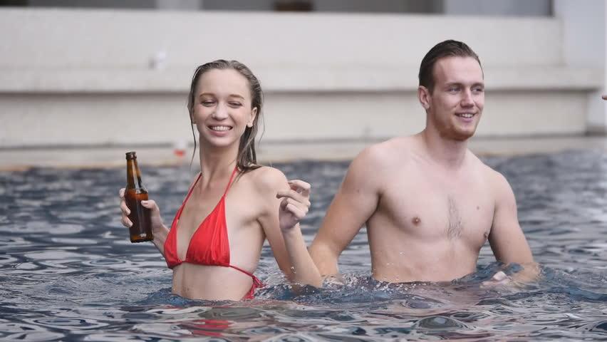 Three Young Women Friends In Bikini Holding Water Bottles ...
