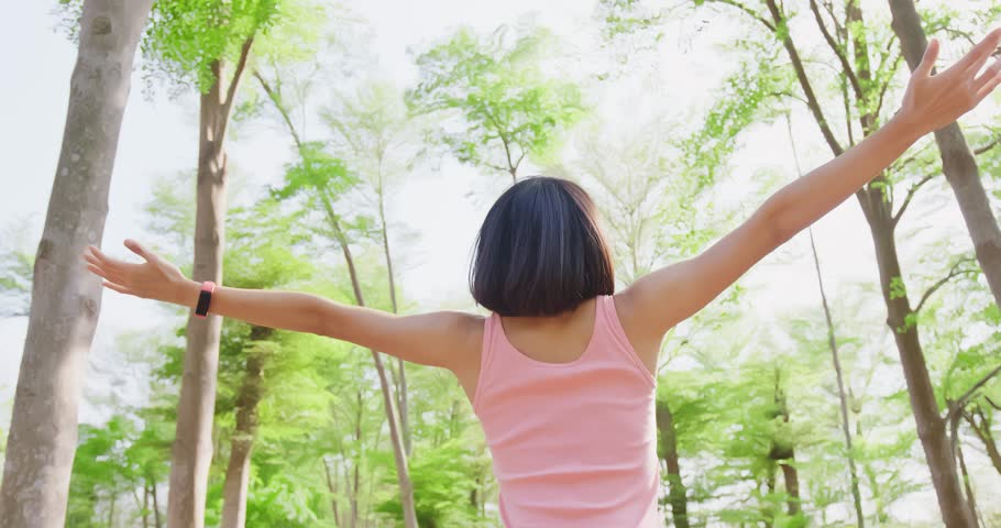 Woman feel free and enjoy in the forest | Shutterstock HD Video #1009670738