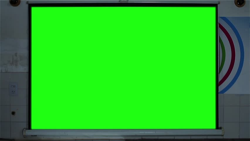 """Projector Screen showing a Green Chroma Key Screen in the School Classroom. Zoom In. You can replace green screen with the footage or picture you want. You can do it with """"Keying"""" effect in AE. 