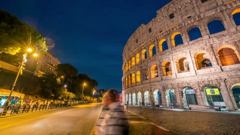 Time lapse of Rome Colosseum and crowded street of Rome , Italy . The Colosseum was built in the time of Ancient Rome in the city center. It is one of Rome most popular tourist attractions in Italy .