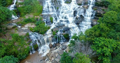 Aerial view of Maeya Waterfall , large waterfall located deep in forest of Chiang Mai, north of Thailand. The beautiful cascade of this waterfall gives a fresh nature landcape for all jungle tourists.