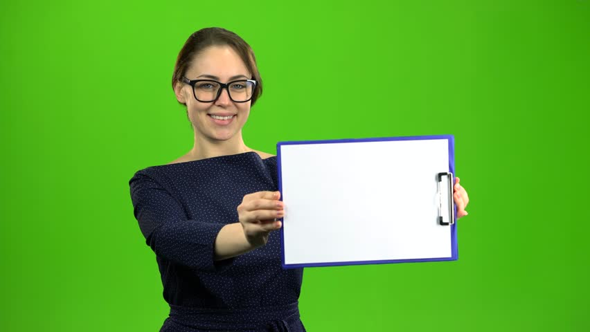 Accountant raises a paper tablet and smiles. Green screen