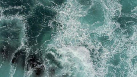 Foaming and splashing Ocean surf.