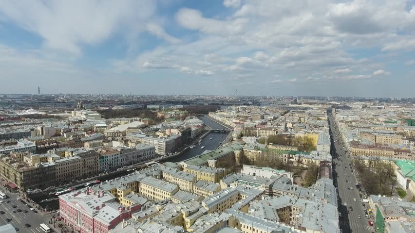 Flight over St. Petersburg. Aerial flight over Saint Petersburg center downtown. View of sightseeing from above. Unique footage. Rooftops and road traffic. Roofs of St. Petersburg | Shutterstock HD Video #1009742108