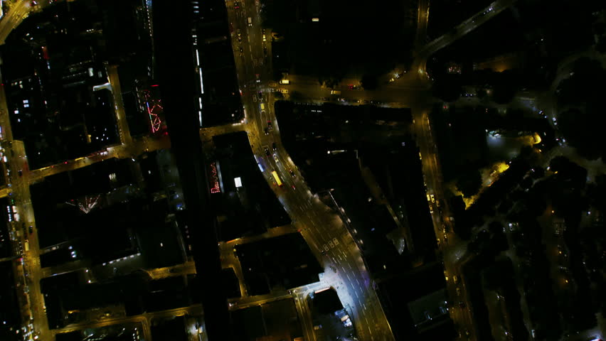 Aerial overhead rooftop view at night Shoreditch railway viaduct A10 vehicle traffic illuminated street lights London England UK RED WEAPON