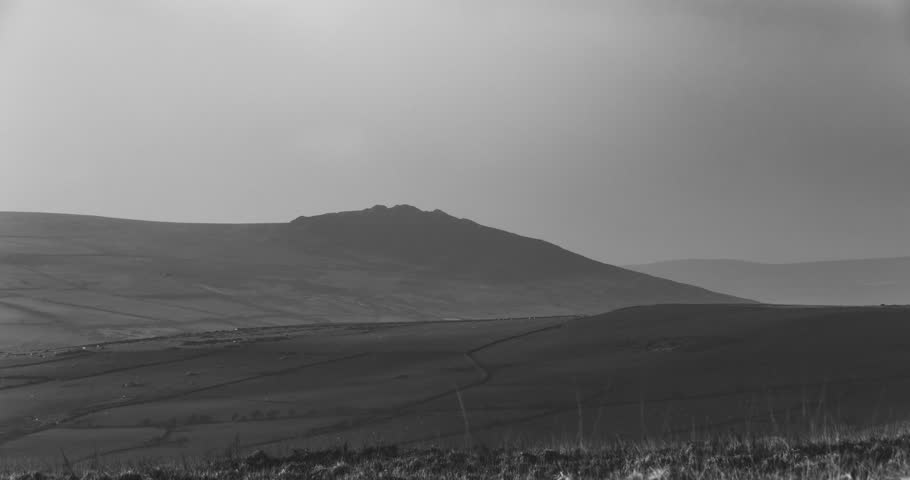Clouds passing over Carn Ingli in the Preseli Hills Pembrokeshire black and white timelapse