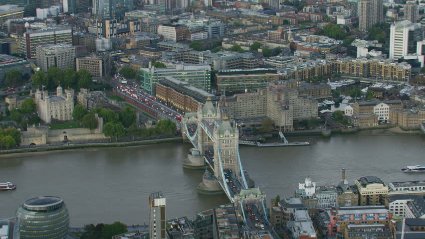 Aerial sunset view City Hall River Thames Tower Bridge commuter vehicles and passenger ferry London England United Kingdom