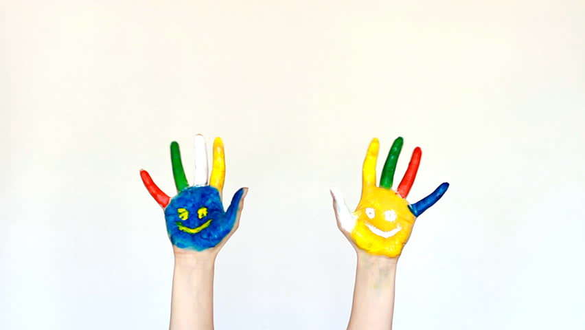 Creative, art and painting. Painted hands multicolored with smiles. White light background. | Shutterstock HD Video #1009823888