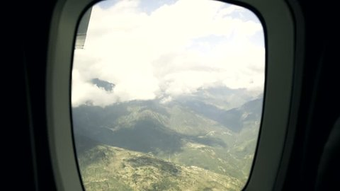 Looking at the Khumbu Valley through an Airplane Window on flight from Lukla, nepal.