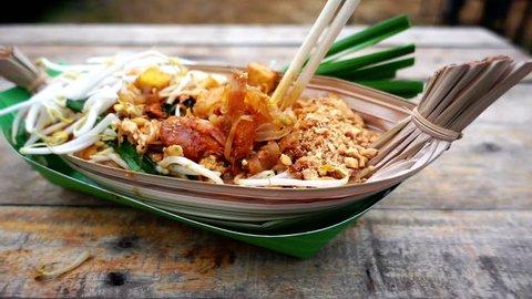 Pad Thai popular food in Bangkok, HD slow motion