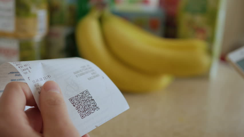 A man scans the QR code on a check from a supermarket. | Shutterstock HD Video #1009905518