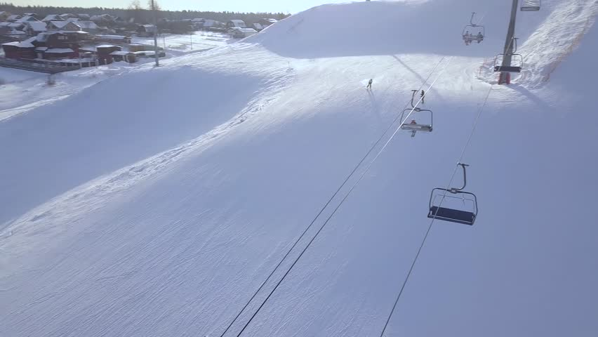 Man skiing on snow mountain in winter ski resort aerial view. Ski holiday and winter sport on snow slope in luxury resort drone view. Winter skiing on snowy mountain