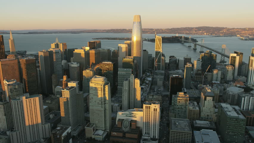Aerial skyline view of downtown Financial district city skyscrapers Salesforce Tower Bay Bridge San Francisco US 80 Pacific ocean California