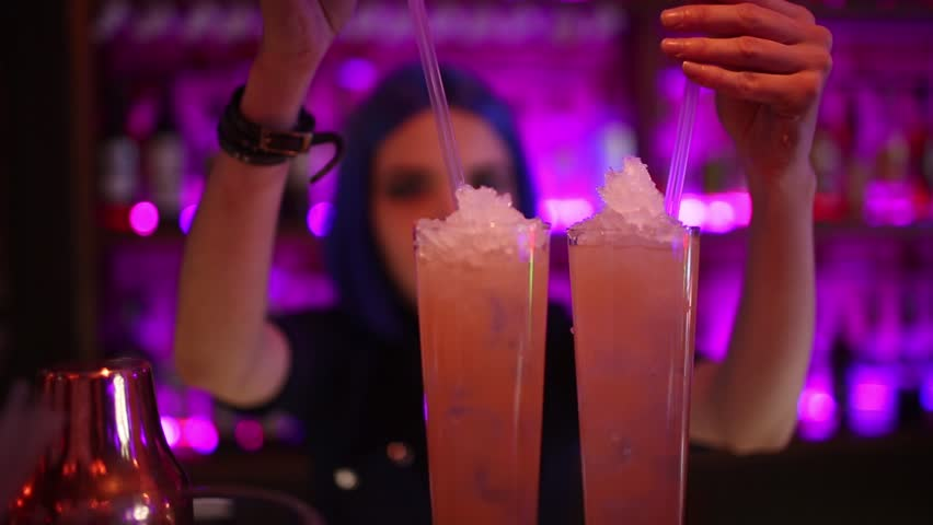 Female bartender. girl with blue hair. cocktail making in night bar   Shutterstock HD Video #1009922288