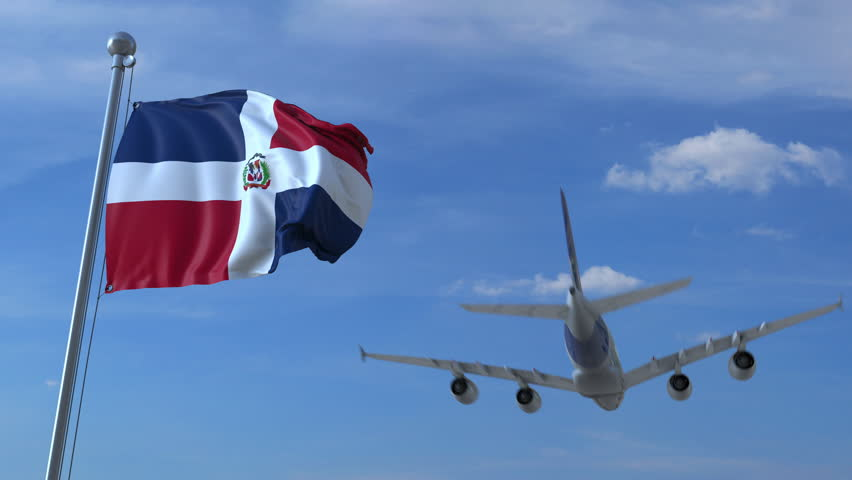Commercial airplane flying above waving flag of the Dominican Republic. Emigration or tourism related animation