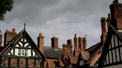 Time lapse of roof and chimney old English village 4K