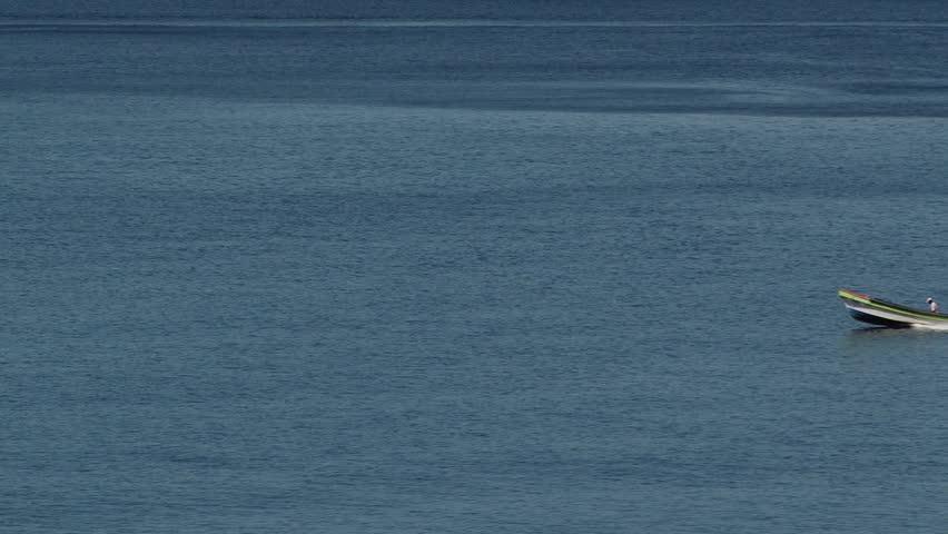 Close shot of small fishing motor boat near shore of Martinique island, Caribbean region