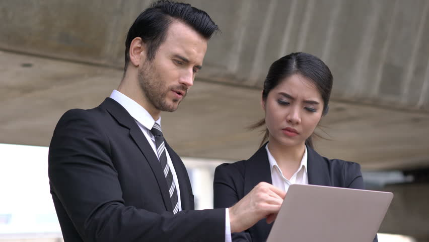 Businessman and Businesswoman talking discuss project together. Concept of project management, business meeting, strategy and performance.   Shutterstock HD Video #1009963118