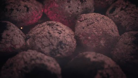 Slow Motion Macro Shot of burning coal / embers