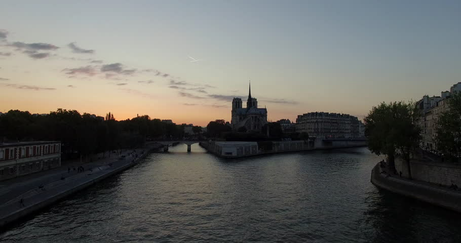 PARIS, FRANCE – SEPTEMBER 2016 : Aerial shot over central Paris island at sunset with view of Notre Dame, Eiffel Tower and river Seine | Shutterstock HD Video #1009990718