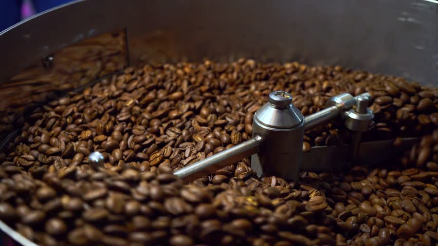 Cooling coffee beans after roasting. Roasting machine, close-up | Shutterstock HD Video #1010003588