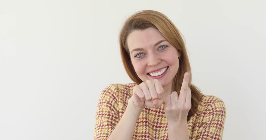 Girl Fuck you isolated. Woman showing middle finger smiling and think fuck you white background