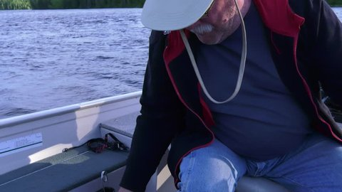 fisherman showing his prized walleye and then drops it
