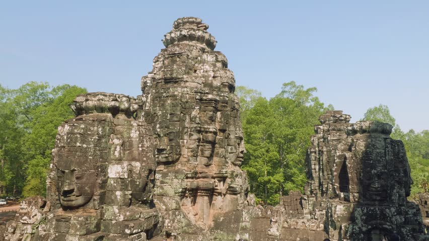 Image of Buddha recognisable in ruins of Angkor Wat temple #1010057498