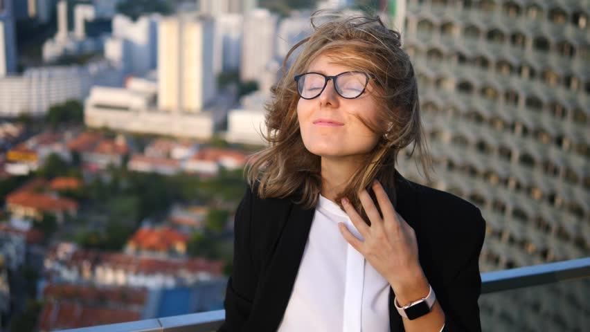 Business Woman Listening Music Using Bluetooth Wireless Earphones In City | Shutterstock HD Video #1010064278