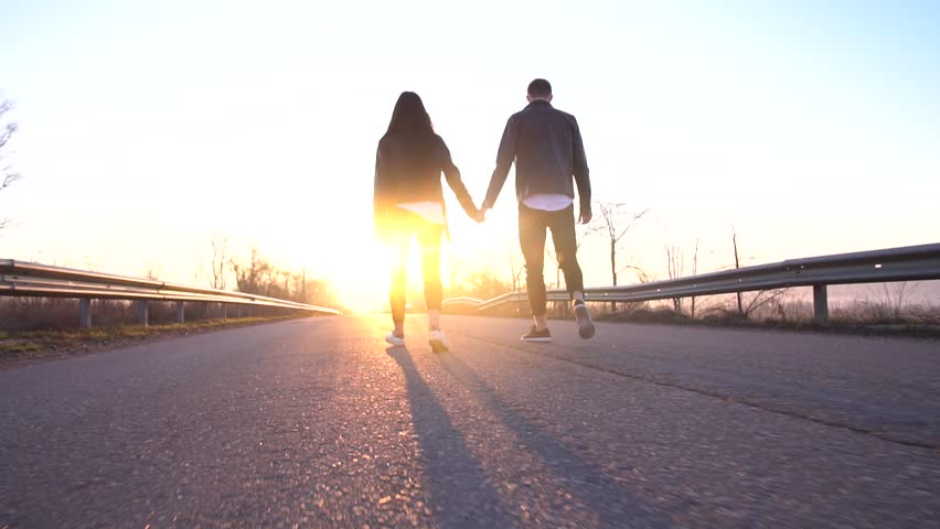 Romantic couple holding hands and children on the road during the dawn, slow motion | Shutterstock HD Video #1010066828