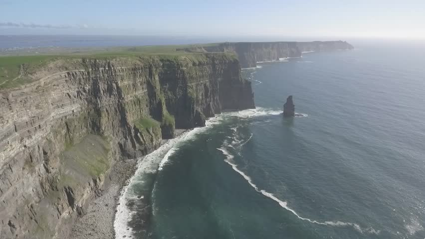 Beautiful Scenic Aerial drone view of Ireland Cliffs Of Moher in County Clare. Sunset over the Cliffs of Moher. Epic Irish rural countryside landscape along the wild atlantic way | Shutterstock HD Video #1010112038
