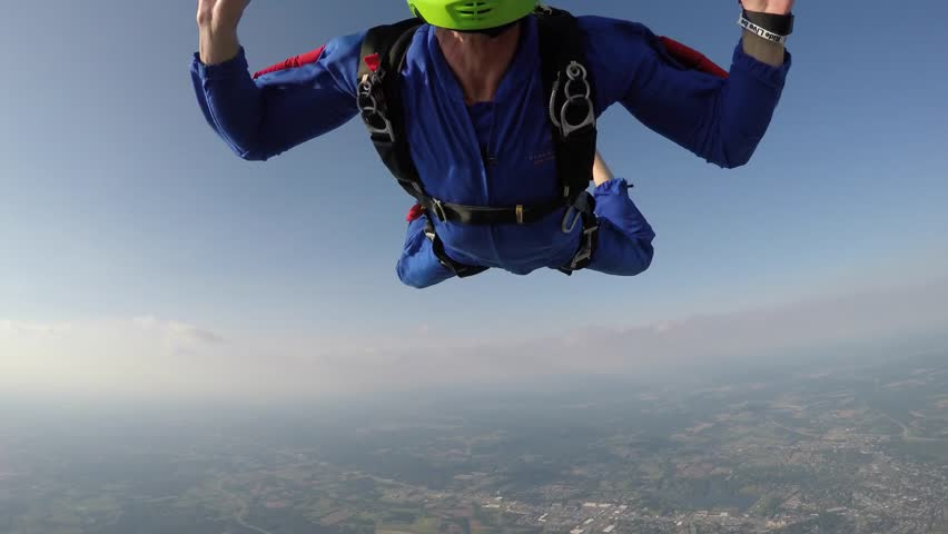 Sky diver woman flying in the sky | Shutterstock HD Video #1010125058