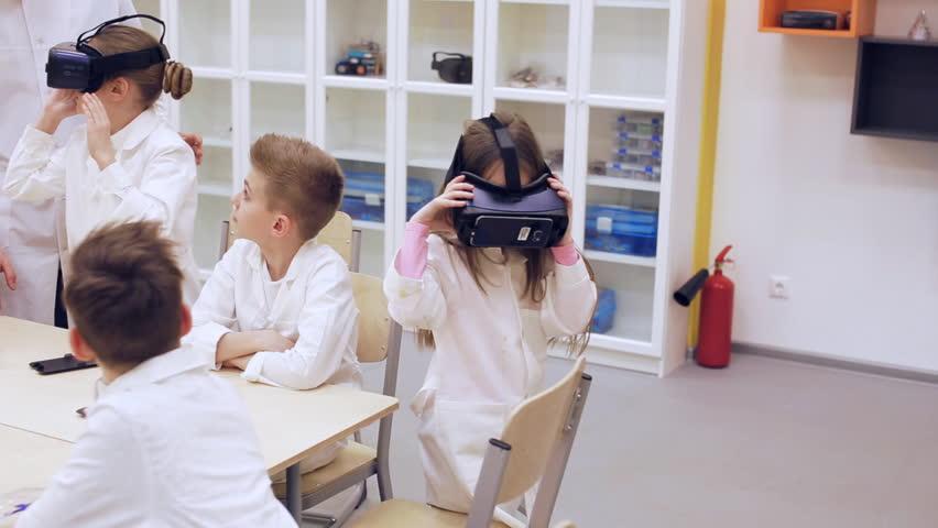 Children learn technology in a modern school | Shutterstock HD Video #1010126828