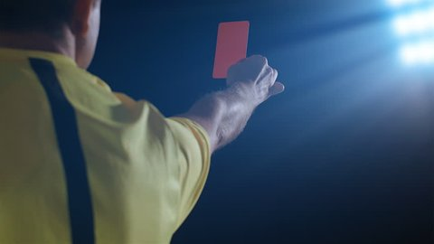 Football soccer referee shows penalty red card