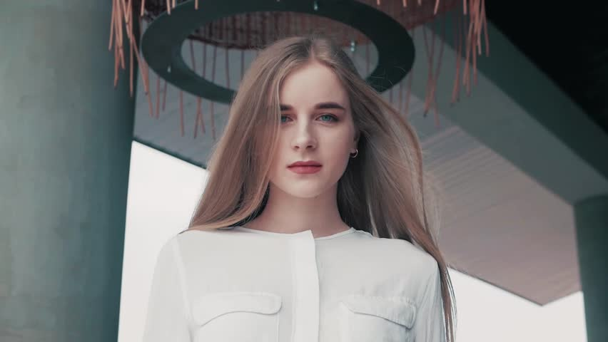Summer lifestyle fashion portrait of young beautiful blonde stylish hipster woman wearing white shirt   Shutterstock HD Video #1010148308
