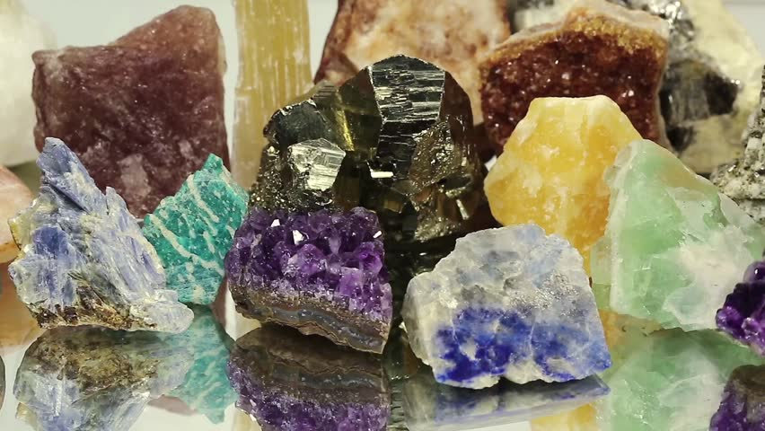 Semiprecious stones and minerals lies on the mirror, the riches of the Earth