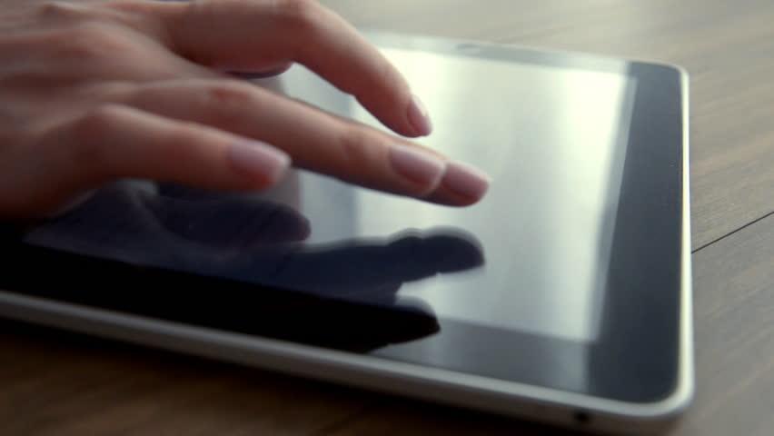 Finger touching tablet computer touchscreen | Shutterstock HD Video #1010180438