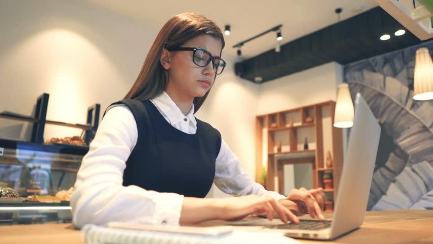 The businesswoman with a headache working at the desktop   Shutterstock HD Video #1010184248