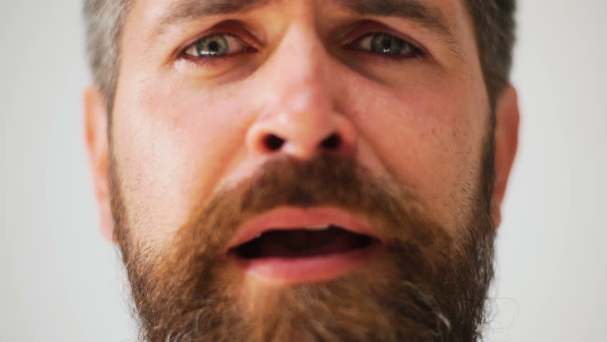 Male facial emotions. Bearded man with different expressions. Young man's portraits with different emotions and gestures. Handsome emotional man. Young man expressing different emotions.   Shutterstock HD Video #1010186588