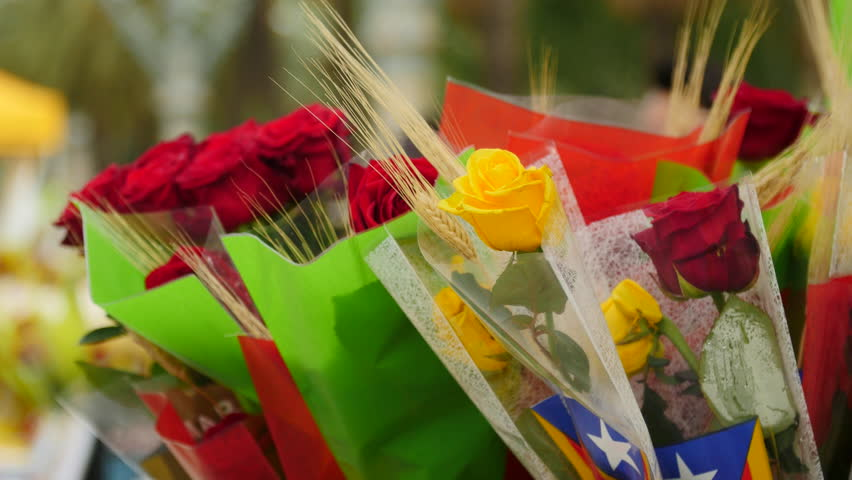 Sant Jordi (St. George), holiday of Catalonia's patron. Men give a rose to women, while women give them a book in exchange. Roses for Sale in a Street Stall.
