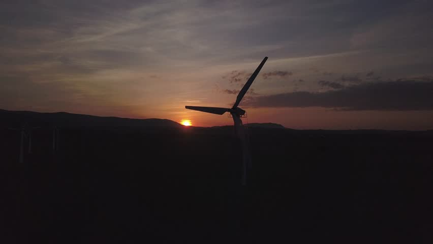 Wind power station in sunset of drone. Romantic evening and modern technologies of ecologically clean electricity. Protection of the environment. Bright Future. An alternative way of extracting energy #1010234108