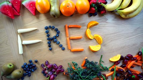 Fresh Word Spelt In Fruit And Vegetables Letters Overhead Time-Lapse, 4K Health. A Variety Of Healthy Eating Words Available.