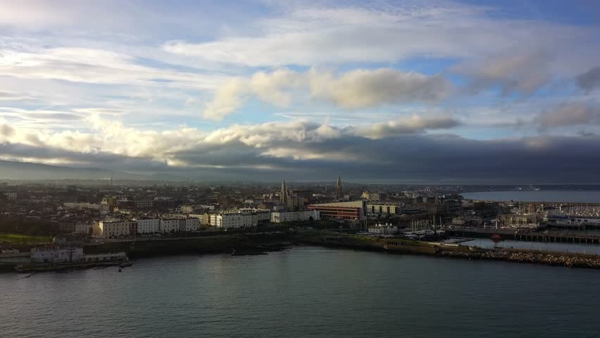 Aerial drone view of Dun Laoghaire, Dublin, Ireland with the sun peaking through the clouds | Shutterstock HD Video #1010361638
