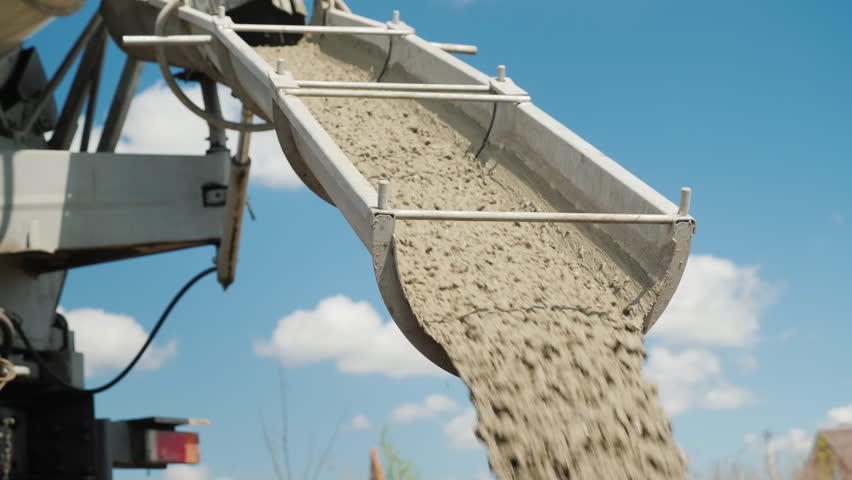 Cement on the troughs follows from the concrete mixer. Delivery of ready-made high-quality concrete concept