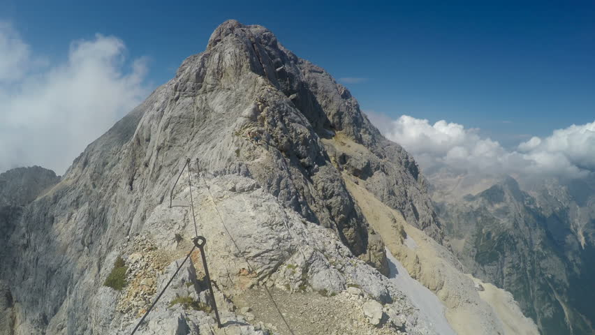 Mountaineer pov to expedition climbing to Triglav summit on Julian Alps mountain range