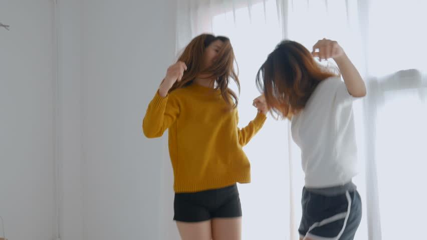 86d7e129d9b Young asian female lesbian couple dancing at bedroom. Lifestyle friendship  concept. L. De LifeHD
