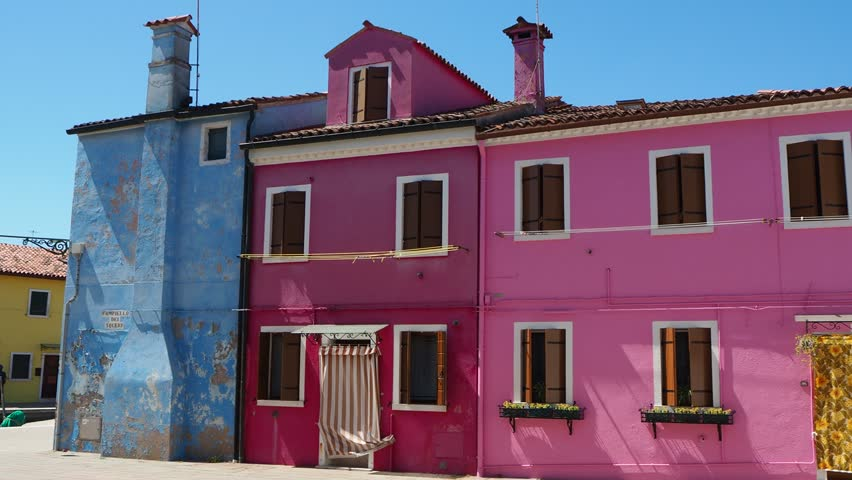 Burano, Venezia, Italy. Street with colorful houses in Burano island   Shutterstock HD Video #1010496188