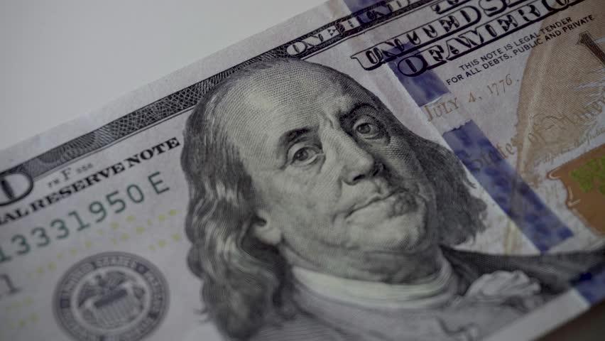 Men's hands of a businessman count 100 dollar bills close-up. A successful transaction during a business meeting   Shutterstock HD Video #1010518358