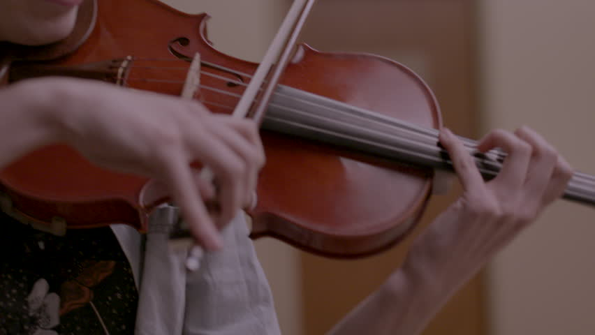 Musician happily playing her violin HD stock video. Alexa camera
