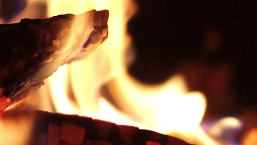 Hot fireplace full of wood and fire, Close-up shot of warm cozy burning fire in a brick fireplace. Burning firewood and coals. Closeup view of red hot glowing wood inside stove. FHD. #1010522738